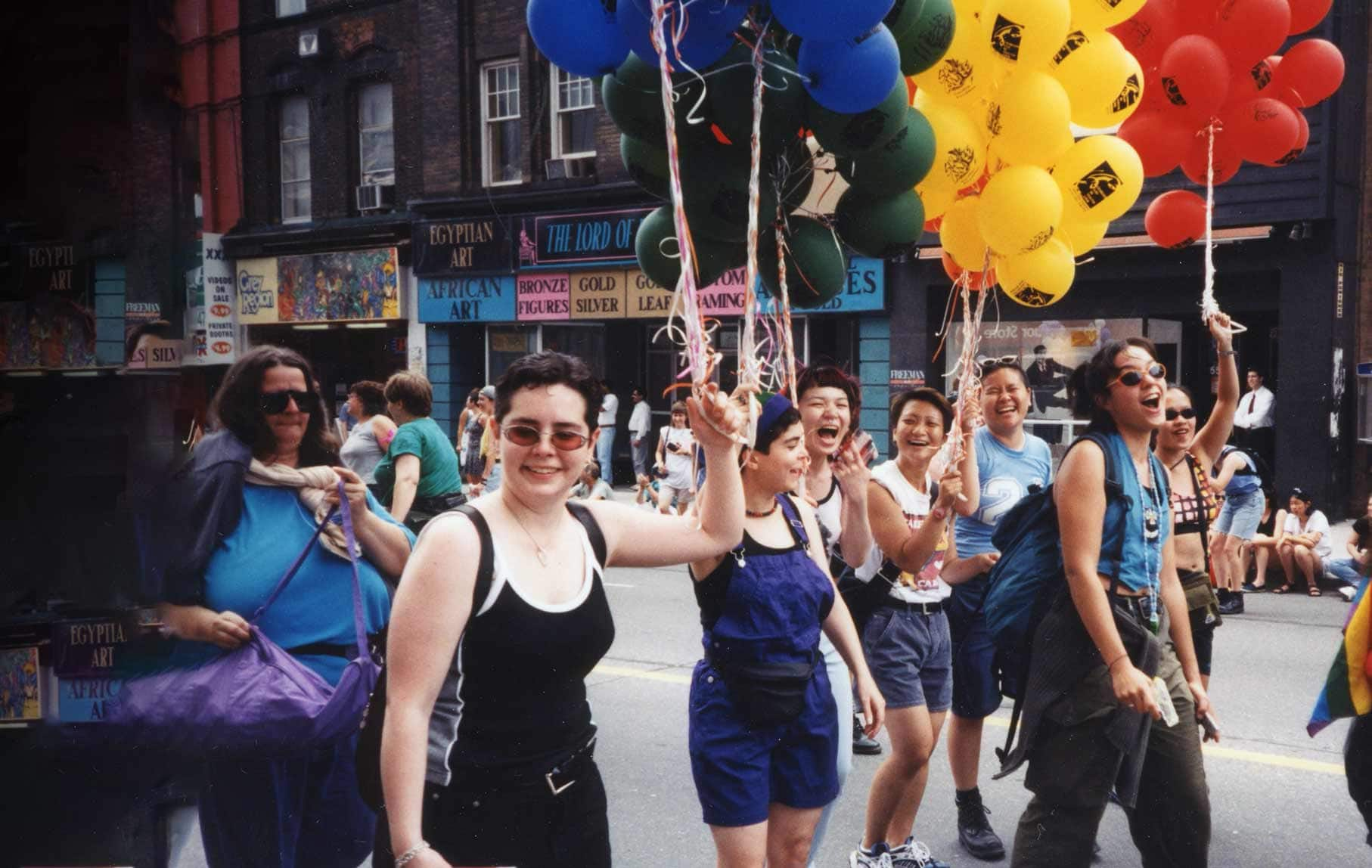 women marching pride parade